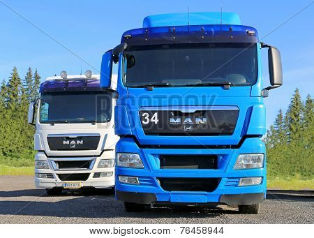 White And Blue Man Truck Tractors