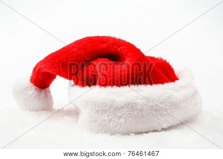 Santa Claus Christmas Red Cap With White Collar On Snow