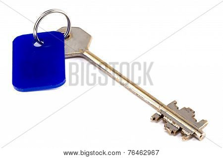Photo of steel key with blue trinket