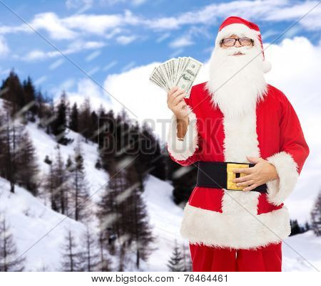 christmas, holidays, winning, currency and people concept - man in costume of santa claus with dollar money over snowy mountains