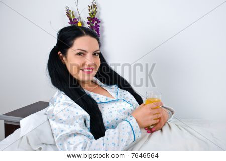 Woman In Bed With Fresh Orange Juice
