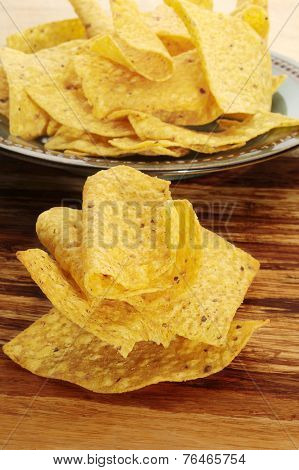 Close-up image of corn chips placed on cutting board