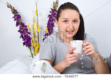 Woman With Coffee In Bed