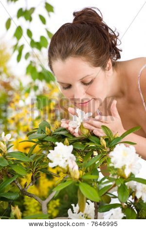 Gardening - Woman Smelling Blossom Flower