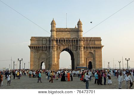 Pedestrians enjoying the evening at the Gateway to India Mumbai