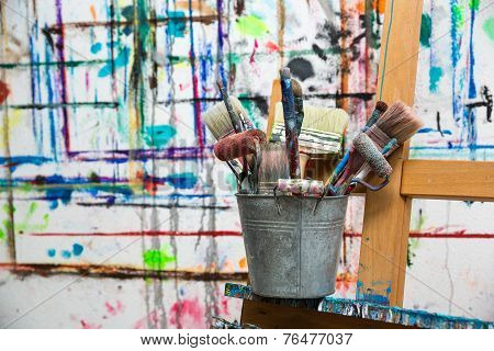 Painter's brushes in a bucket