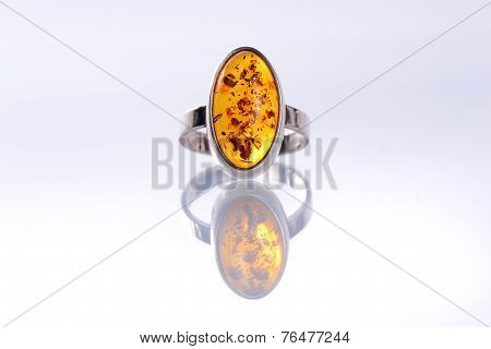 Ladies silver ring with amber stone with reflection