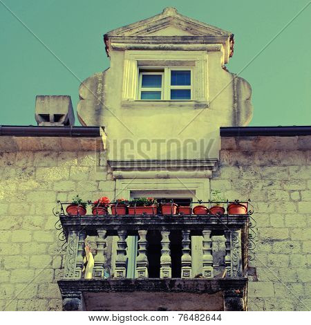 Balcony With Flower Pots In Old European Town