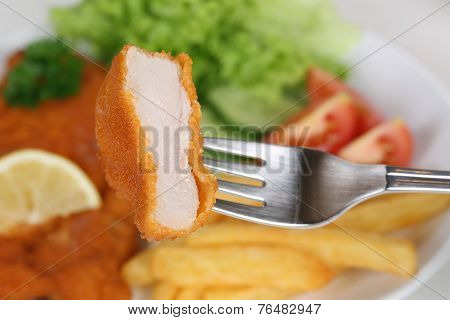 Eating Schnitzel Chop Meal With Fork