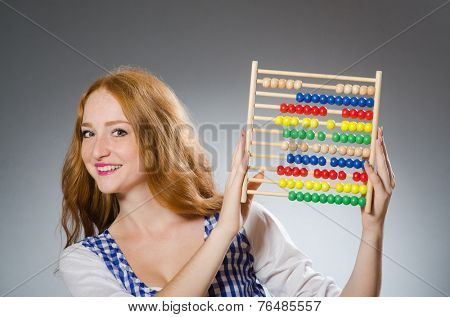 Young woman with abacus in school education concept
