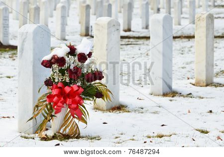 Tombstones in snow - Arlington National Cemetery in Washington DC, USA