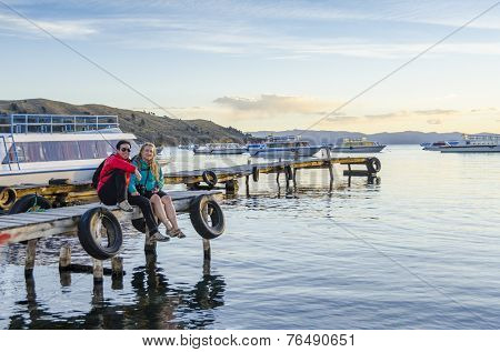 Young couple in port in Copacabana, Titicaca Lake, Bolivia