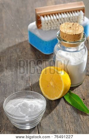 cleaning tools with lemon and sodium bicarbonate on wood