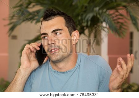 Male Model On His Cell Phone Shrugging His Shoulders Questioning