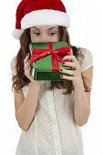 picture of peek  - Curious christmas woman peeking into gift box - JPG