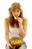 stock photo of potato chips  - lovely girl eating potato chips - JPG