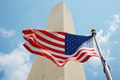 foto of washington monument  - Washington Monument and national flag of USA in Washington DC, USA