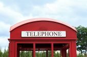 stock photo of phone-booth  - Detail of old red English phone booth in countryside - JPG