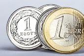 image of zloty  - One euro and one zloty coin as an exchange symbol - JPG