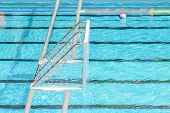 stock photo of swim meet  - Water Polo Goal And Ball In Swimming Pool - JPG
