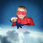 picture of crusader  - Superhero child flying above the clouds concept for childhood - JPG