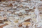 stock photo of andes  - Maras salt mines in the peruvian Andes at Cuzco Peru - JPG
