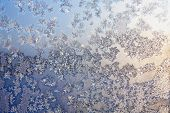 foto of frozen  - Frozen snowflakes and frost magic pattern with sunlight on Christmas winter window - JPG
