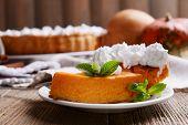picture of pumpkin pie  - Piece of homemade pumpkin pie on plate on wooden background - JPG