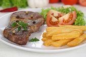 image of pork cutlet  - Pork chop steak cutlet meat meal with fries vegetables and lettuce on plate - JPG