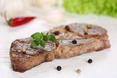 picture of pork cutlet  - Pork chop steak cutlet meat on a wooden table - JPG