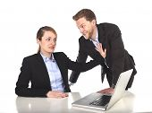pic of inappropriate  - young attractive businesswoman suffering sexual harassment and abuse of colleague or office boss touching her at work with excessive familiarity in work relationship concept - JPG