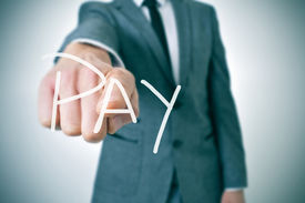 picture of verbs  - man in suit pointing the finger to the word pay written in the foreground - JPG