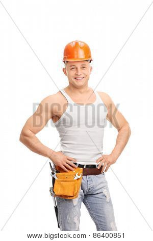 Vertical shot of a handsome construction worker wearing a helmet and a tool belt isolated on white background