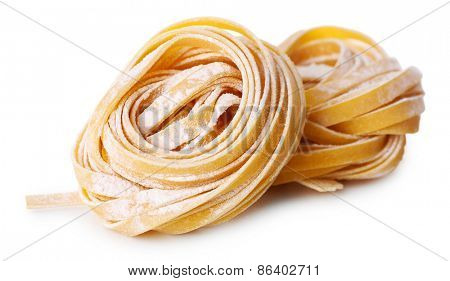 Pasta tagliatelle nests isolated on white