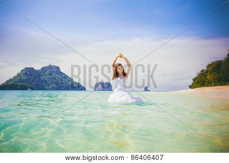 Brunette Bride Smile Playing In Azure Water