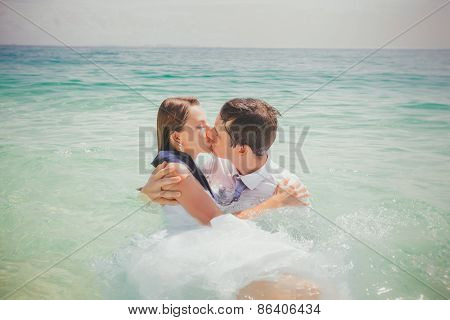 Dressed Bride And Groom Kiss