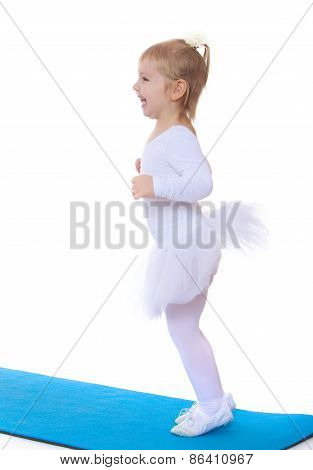 Cheerful little girl in a tutu