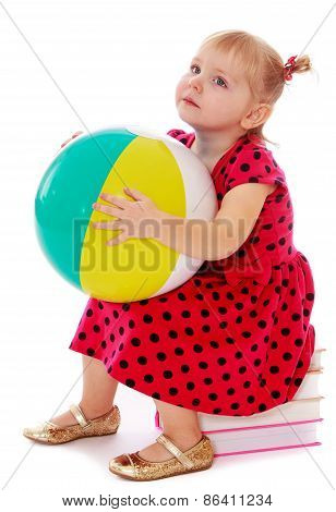 Girl with a bouncy ball