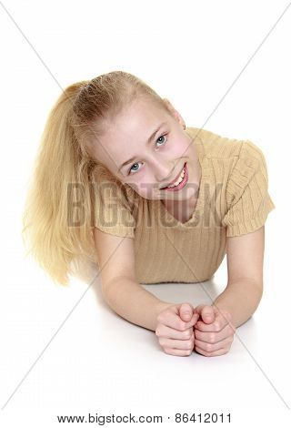 Smiling girl lying on the floor