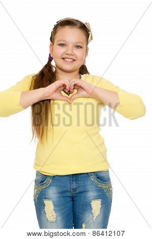 The girl folded hands heart