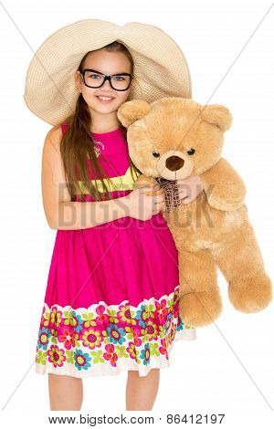 The girl in the hat and glasses with Teddy bear