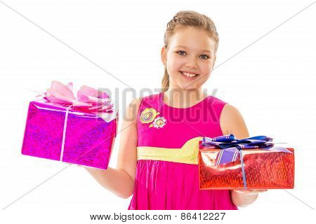 Girl in pink dress holding gifts