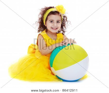 Joyful girl in a yellow dress