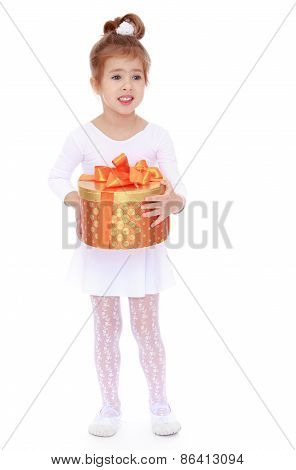 Girl in a white dress holding a gift box