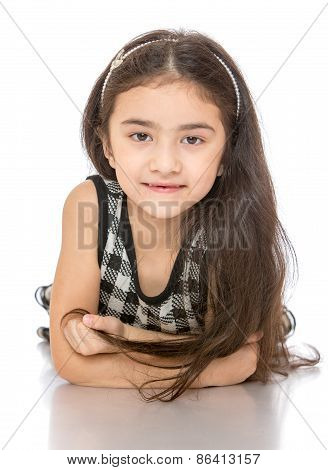Portrait of beautiful dark-haired little girl