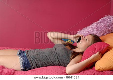 Teen Girl Talking On Telephone