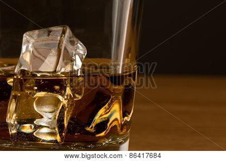 Close Up Shot Of Whiskey With Ice Cubes