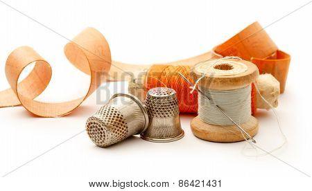 Sewing Thimbles, Bobbins And Needle