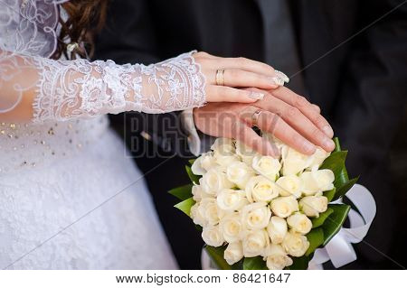 Hands And Rings And Wedding Bouquet