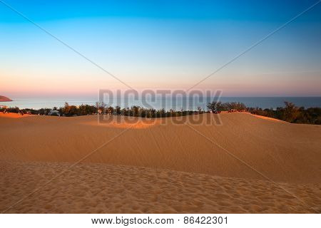 Red sand dunes in Mui Ne at sunset, Vietnam